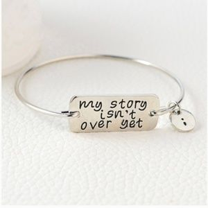 New! My Story Isn't Over Yet Charm Bracelet